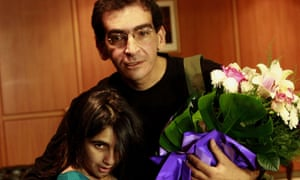 Lebanese journalist Fidaa Itani, who was abducted by a rebel group in northern Syria, poses with his daughter, Farah upon his arrival at Beirut airport.