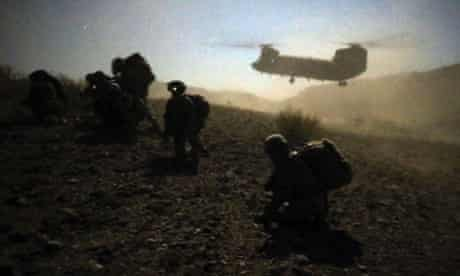 U.S. and Afghan soldiers rest during an operation near the town of Walli Was in Paktika province, Afghanistan.