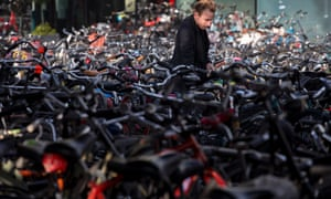 Bike city: a man parks his bicycle near Central Station in Amsterdam.
