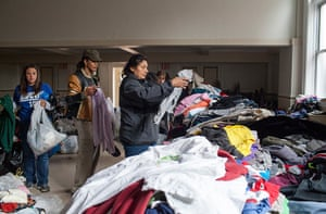Superstorm sandy supplies: A woman searches a pile of donated clothing
