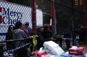 Superstorm sandy supplies: People stand in a queue for basic supplies