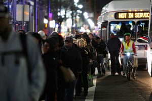 Superstorm sandy supplies: People line up on along a street in Manhattan to take buses