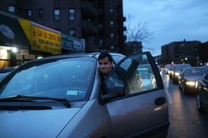 Superstorm sandy supplies: Jahongir Ibadov pushes his car in a long line at a filling station