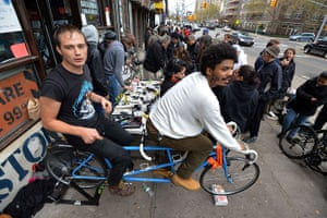 Superstorm sandy supplies: Ryan Nelsen and Fields Harrington ride a tandem bicycle to generate power