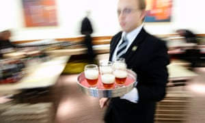 A waiter with a tray of beers during the Brussels beer challenge. Brewers from 16 countries gathered for a three-day beer tasting contest.