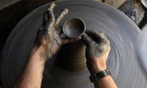 More pottery news: a potter makes earthenware oil lamps in preparation for the Nepalese festival of Tihar in Bhaktapur, on the outskirts Kathmandu.