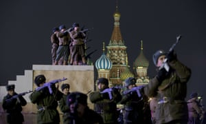 Russian soldiers take part in a rehearsal of a military parade marking the 71th anniversary of a historical parade of 1941