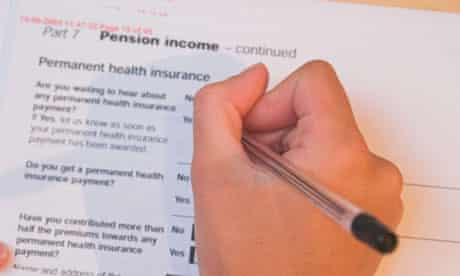 A woman fills out an application form for state benefits