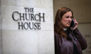 A female member of the clergy talks on the phone outside Church House on 20 November 2012.