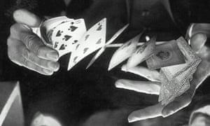 A man shuffling a deck of cards