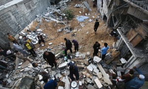 Palestinians inspect the destroyed house of the Hejazi family hit during an Israeli air strike in Beit Lahia, in the northern Gaza Strip on Tuesday.  Photograph: Ali Ali/EPAI