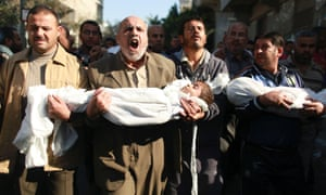 Palestinians carry the bodies of two boys during their funeral in Beit Lahiya in the northern Gaza Strip on Tuesday.  The two children and their father Fuad Hejazi were killed when an Israeli air strike crushed their home on Monday, the Hamas Health Ministry said.