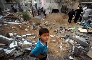 Israel Gaza : Palestinians inspect a destroyed house in Beit Lahia, in the Gaza Strip