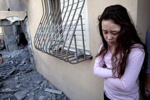 Israel Gaza : An Israeli girl stands outside her house in Beersheba, Israel