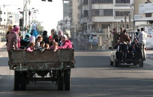 Israel Gaza : Palestinian families evacuate their homes following an Israeli air strike