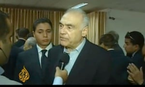 Egyptian foreign minister Mohamed Amr speaks to media at a border crossing into Gaza, in a screen grab from Al-Jazeera.