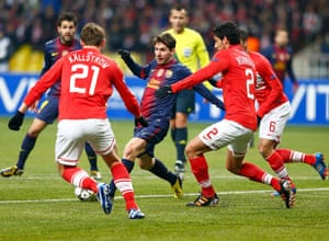 Tuesday champions league: Spartak Moscow's Kallstrom & Insaurralde vie with Barcelona's Lionel Messi