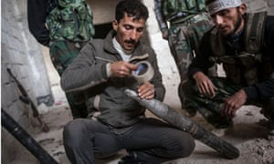 Syrian rebel fighters' homemade rocket launcher