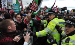 Protestors scuffle with police during a student rally in central London against sharp rises in university tuition fees, funding cuts and high youth unemployment.
