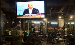 Israeli soldiers watch the prime minister Netanyahu announce the ceasefire.