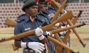 Members of the Indian National Cadet Corps (NCC) perform a rifle drill during the 64th NCC day celebrations in Secunderabad, Indian.