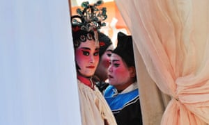 Performers wait backstage before an opera show in Xihuang village of Zouping, Shandong province, China. Villagers in Xihuang started an opera company in 1998 to preserve some classic local operas, mainly Lv and Wuyin, which represent farmers' lives and love stories. The company has about about 30 village members and has put on nearly 300 shows for free.