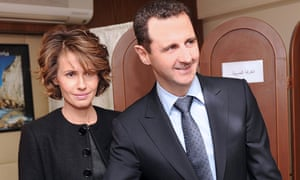 Syrian president Bashar al-Assad accompanied by his wife Asma posing for a photograph while casting his vote, during a referendum on new constitution in February.