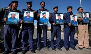 Yemeni air force officers hold posters of victims who died in a military plane crash yesterday, during their funeral procession in Sanaa, Yemen. The military plane crashed during training over the capital, Sanaa, killing all 10 people on board.