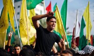 "A Palestinian celebrates ""victory"" over Israel, Gaza City"