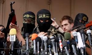 Palestinian Islamic Jihad militants hold a press conference in Gaza City.