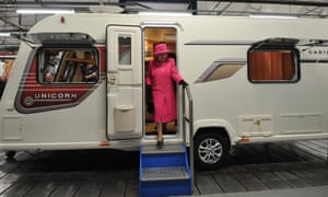 It's like a palace on wheels: the Queen steps out of a caravan during a visit to the Bailey caravan factory as part of her Jubilee tour in Bristol, England.