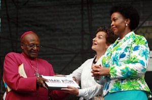 Kyoto history: Archbishop Desmond Tutu hands over a Climate Justice Diary