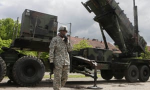 US soldier stands next to a Patriot surface-to-air missile battery at an army base in Morag, Poland. Turkey's government requested the deployment of Nato's Patriot surface-to-air missiles on Wednesday