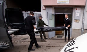 Undertakers take away the body of a victim after a former employee shot dead three former colleagues at a Slovak engineering firm.