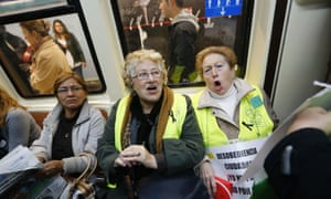 Members of the pensioner association Yayoflautas shout slogans inside a subway train after a protest at the Pharmacies Association against Madrid's one-euro surcharge for medical prescriptions next year.