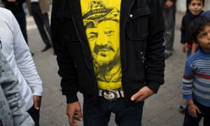 A Palestinian man wears a shirt with the image of the late Palestinian leader Yasser Arafat at Shifa Hospital in Gaza City.