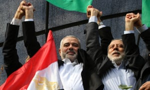 Senior Hamas leader Ismail Haniyeh waves to crowds of people celebrating the ceasefire in Gaza city.