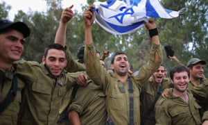 As Israeli soldiers dance to music provided by visiting Hassidic Jews on the border with Gaza.