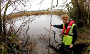 Hydrologist Josh Johnstone from Hydro Logic in Stirling holds a water staff gauge