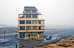 China demolition: A house sits in the middle of a newly built road in Wenling city, China