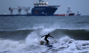 It's an ill wind: a surfer braves the waters of the North Sea off the Esplanade, Aberdeen.