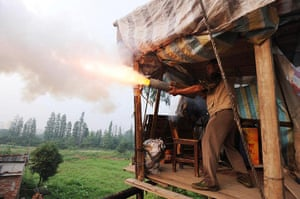 China demolition: Chinese farmer Yang Youde fires his homemade cannon