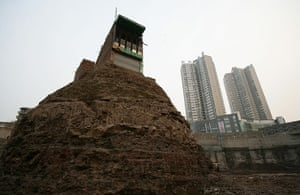 China demolition: Household Who Refused To Move Out Surrounded By Excavation