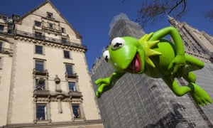 The Kermit the Frog balloon makes its way down Central Park West during the annual Macy's Thanksgiving Day parade.