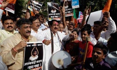 People in Mumbai celebrate the decision to hang Ajmal Kasab