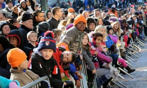 Children watch the Thanksgiving day parade in New York City.