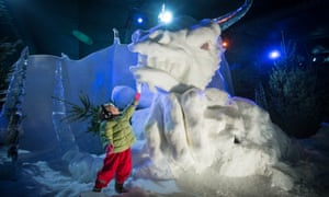 Children play in the Magical Ice Kingdom at Winter Wonderland in Hyde Park