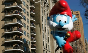 The Smurfs balloon floats down Central Park West during the 86th Macy's Thanksgiving Day Parade