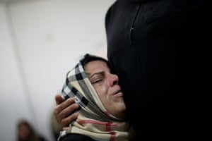 Bernat Armangue: A Palestinian relative cries during the funeral of Mohammed al-Koumi