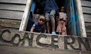 Children look on from their shelter at a roadside IDP camp of Mugunga, between Goma and Sake, in the eastern Democratic Republic of Congo.